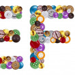 Characters E and F made of clothing buttons — Stockfoto #7381636