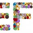 Characters E and F made of clothing buttons — Stock Photo #7381636