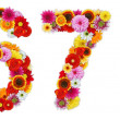 Foto Stock: Numbers 6 and 7 made of various flowers