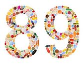 Numbers 8 and 9 made of various colorful pills — Stock Photo