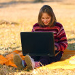 Royalty-Free Stock Photo: Girl sitting outdoors with laptop