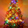 Christmas tree shot with cross screen filter — Stockfoto