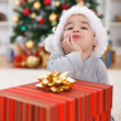 Cute boy with big Christmas present — Stock Photo