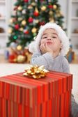 Cute boy with big Christmas present — Stockfoto