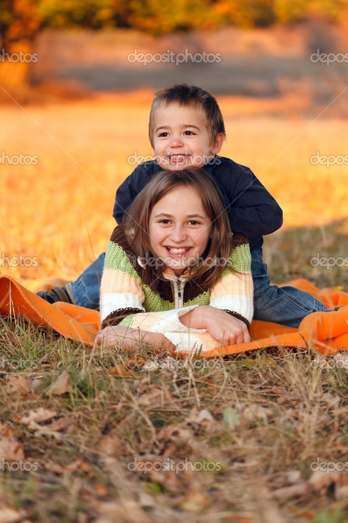 Happy kids playing outdoors in autumn — Stock Photo #7936445