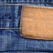 Blank leather label on jeans - Stock Photo