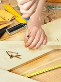 Man's hands screwing bolt — Stok fotoğraf