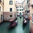 Motion-blurred traditional gongola boats in Venice, Italy — Stock Photo