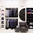 图库照片: Stylish men's clothes in shop