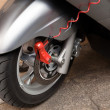 Red lock on motorbike — Stock Photo #7427025