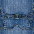 Stock Photo: Blue denim with strap and yellow metal clasp