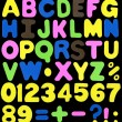 Alphabet made of neon color sponge alike soft plastic — Stock Photo