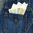 Jeans and money — Stock Photo