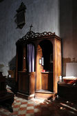 Christian confessional in mysterious light — Stok fotoğraf