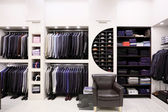 Stylish men's clothes in shop — Stock fotografie