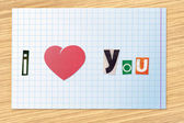 "Phrase ""I love You"" on a checkered paper — Stock Photo"