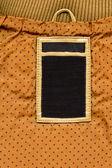 Couro e jeans escuro etiqueta tecido pontilhado amarelo — Fotografia Stock