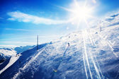 Skiing at sunset — Stock Photo