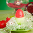 Easter table setting in green and red — Stock Photo