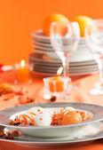 Easter table setting in orange tones — Stock Photo