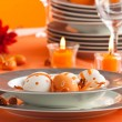 Foto de Stock  : Easter table setting in orange tones