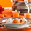 Easter table setting in orange tones — Stock Photo