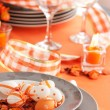 Easter table setting in orange tones — Stok fotoğraf