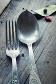 Fork and knife in rustic setting — Stock Photo