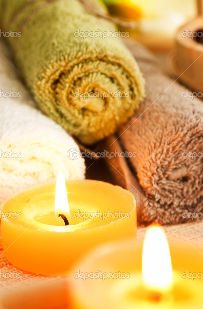 Spa setting with candles, waterlily and pebbles. Selective focus  Stockfoto #6994168