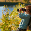 Little boy looking through binocular — Stock Photo