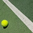 Tennis ball on court — Stock Photo