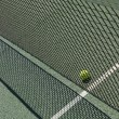 Tennis court net and ball — Stock Photo