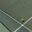 Tennis court net and ball — Stock Photo #7311090