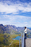 Young woman in a viewpoint of Swiss Alps — Stock Photo
