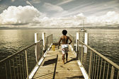 Small children playing in a dock of the french Lake Leman Riviera — Stock Photo