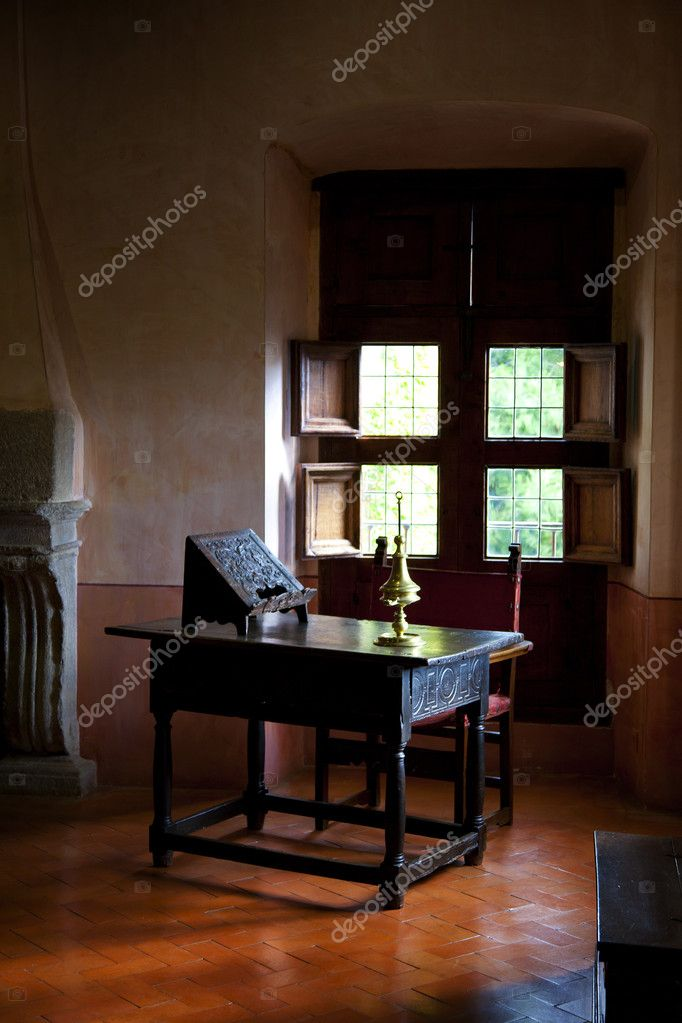 Antique writing desk in a rural interior  Stock Photo #7534093