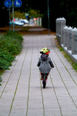 Three year old child with training bike — Stock Photo