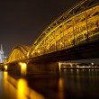 Cologne Cathedral and Hohenzollern Bridge at night, Cologne, Germany - Stock Photo