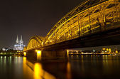Cologne Cathedral and Hohenzollern Bridge at night, Cologne, Germany — Stock Photo
