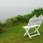 Bench on ocean shore — Stock Photo #6980148