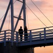 Couple watching sunset - Foto Stock