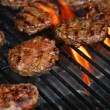 Foto Stock: Hamburgers on barbeque