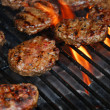 Hamburgers on barbeque - Stock Photo