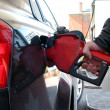 Stock Photo: Gas pump fueling