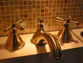 Brass faucet bathroom — Stock Photo