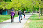 Bicycling in a park — Stock Photo