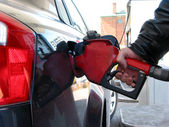 Gas pump fueling — Stock Photo