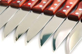 Steak knives row — Stock Photo