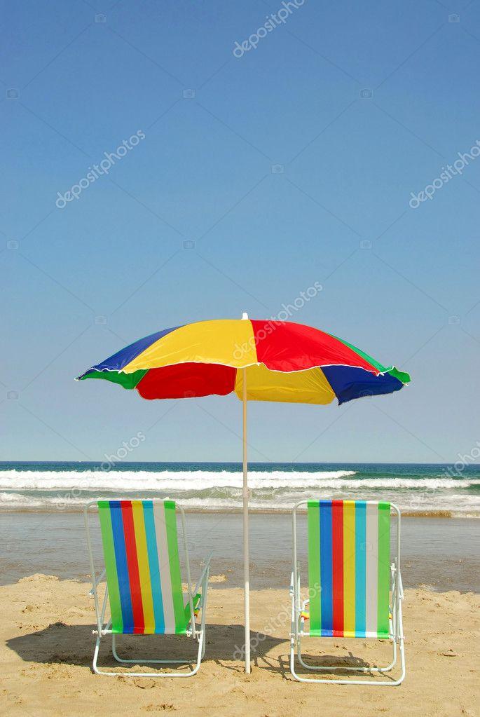 Beach chairs and umbrella — Stock © elenathewise