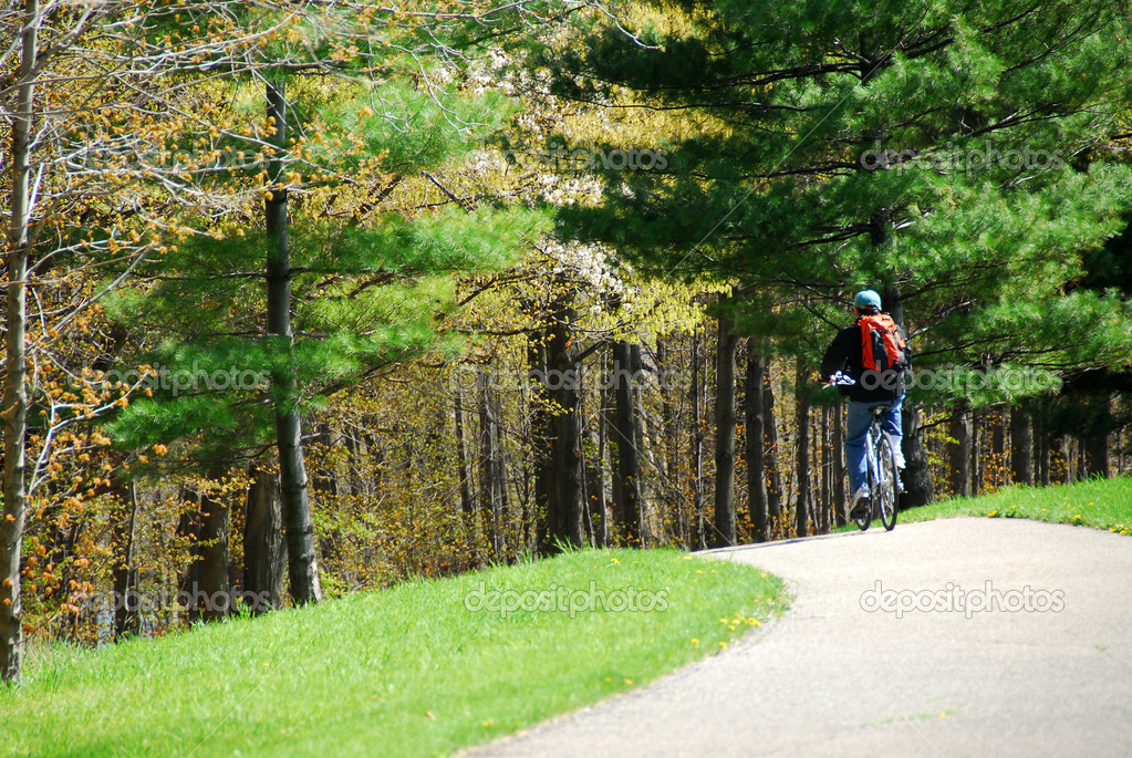 Man on bicycle on a trail — Stock Photo #6980384